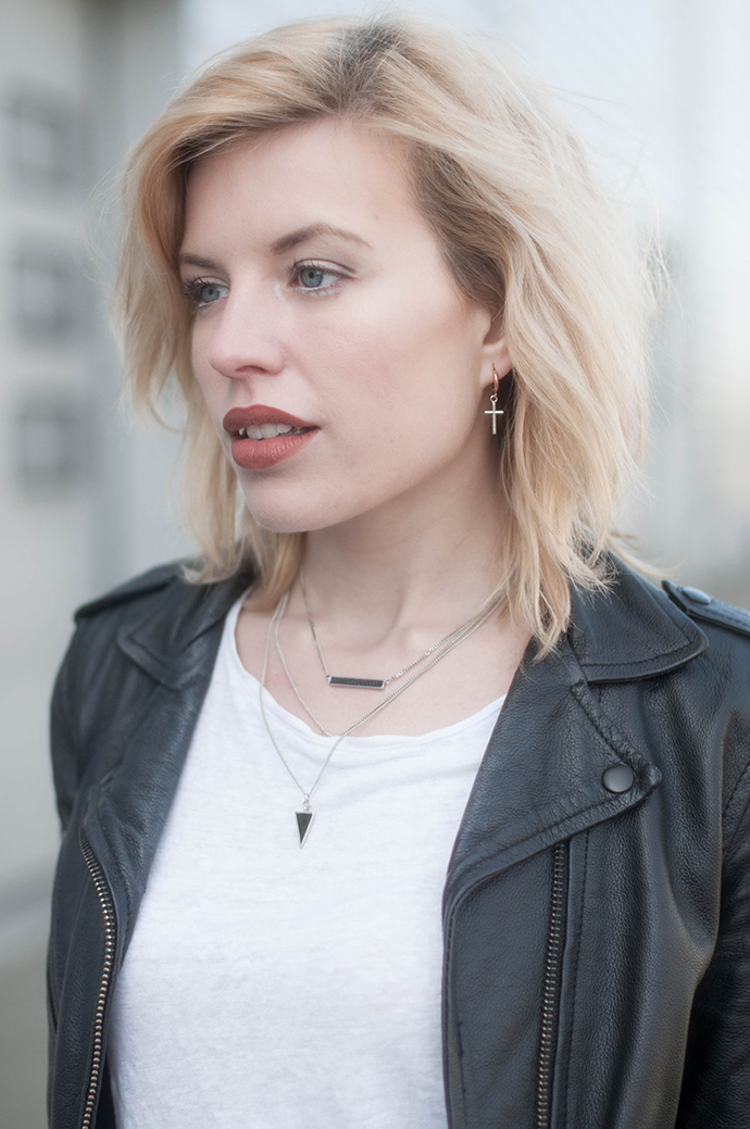 RED REIDING HOOD: Fashion blogger wearing leather jacket multiple necklaces cross earring outfit details