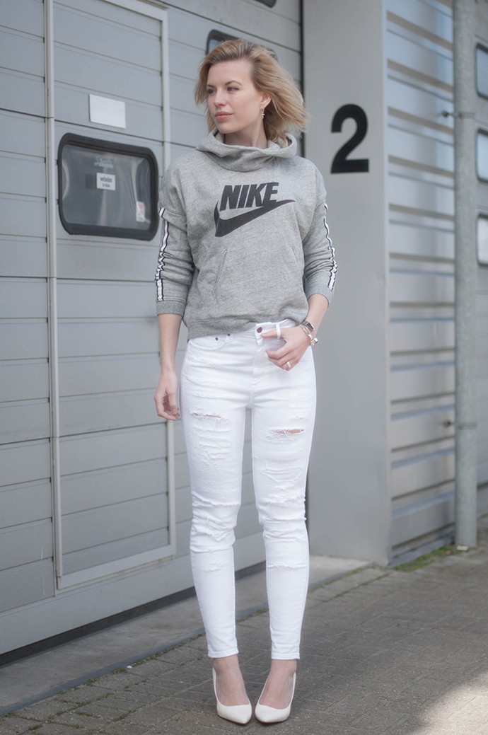 RED REIDING HOOD: Fashion blogger wearing high waisted denim distressed ripped jeans nike logo sweater outfit wedge heels