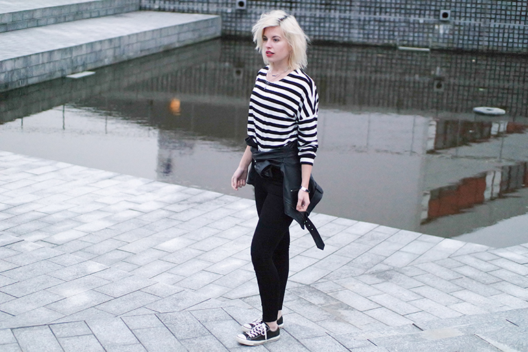 RED REIDING HOOD: Fashion blogger wearing stripes top leather jacket tied around the waist converse all stars outfit