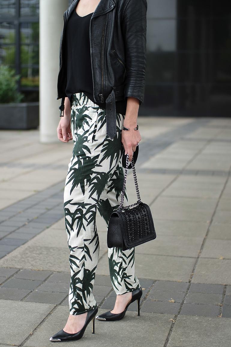 RED REIDING HOOD: Fashion blogger wearing ganni palm leafs print pants guess heels leather biker jacket chanel boy bag outfit details