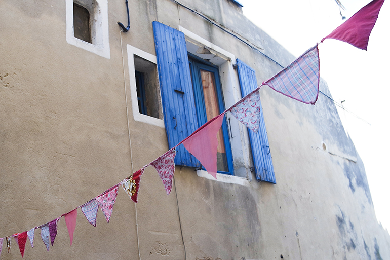 RED REIDING HOOD: Cute flags in Barjac medieval city travel blogger