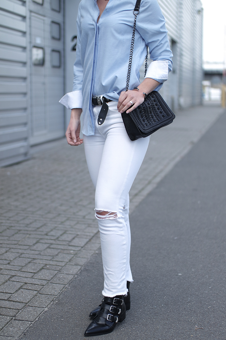 RED REIDING HOOD: Fashion blogger wearing white distressed jeans ripped knees oxford shirt buckle boots outfit details