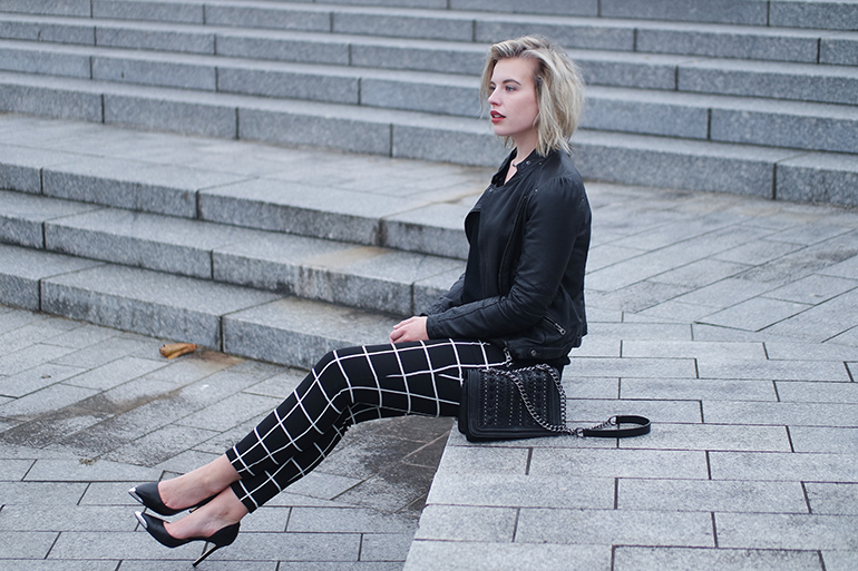 RED REIDING HOOD: Fashion blogger wearing grid pants leather jacket outfit guess heels
