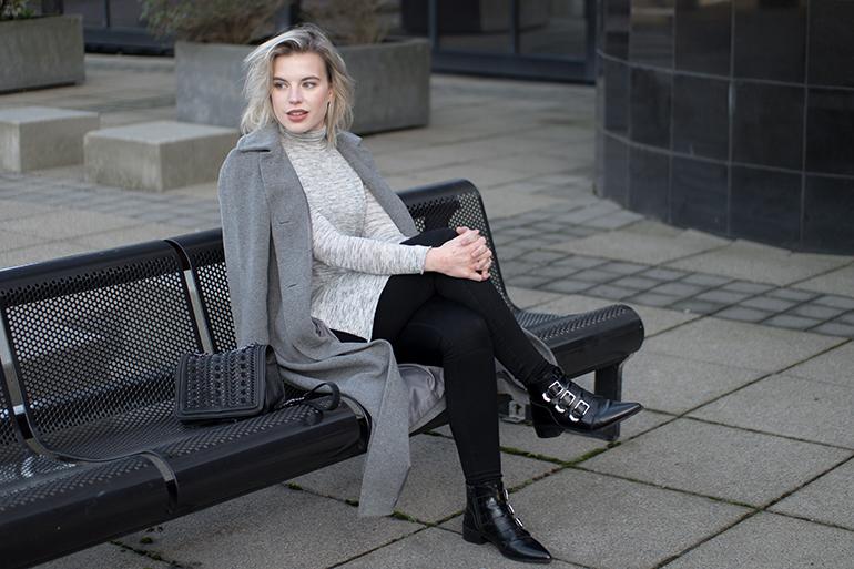 RED REIDING HOOD: Fashion blogger wearing supertrash buckle ankle boots side split turtleneck top grey long coat outfit