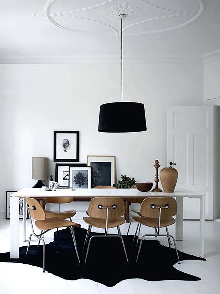 RED REIDING HOOD: Black cowhide rug minimal interior scandinavian style