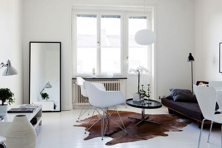 RED REIDING HOOD: Brown cowhide rug minimal interior scandinavian style