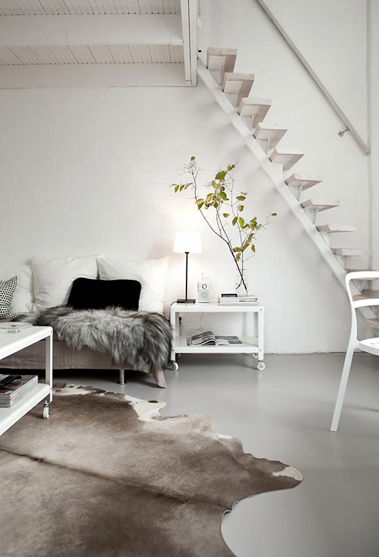 RED REIDING HOOD: Brown cowhide rug minimal white interior cosy scandinavian style