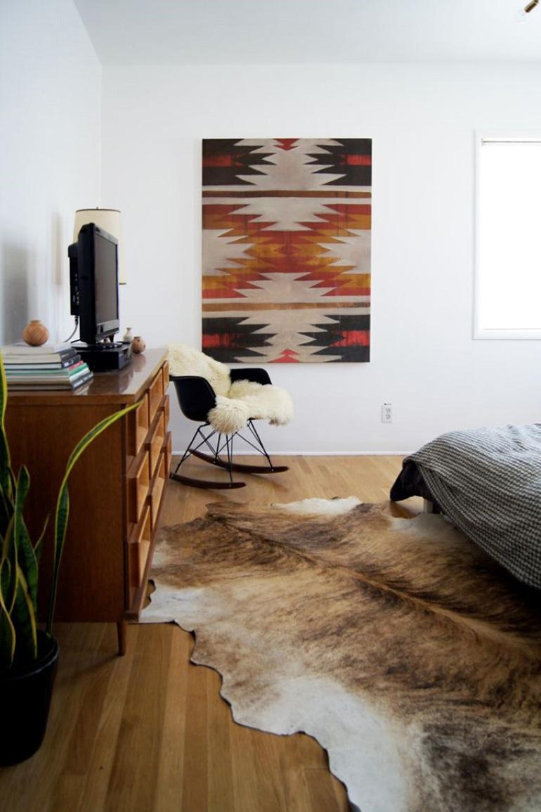 RED REIDING HOOD: Brown cowhide rug boho interior hippie style aztec bedroom