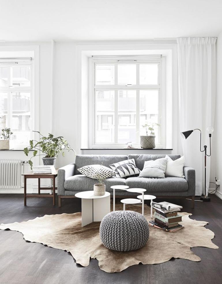 RED REIDING HOOD: Light brown cowhide rug minimal grey interior scandinavian style