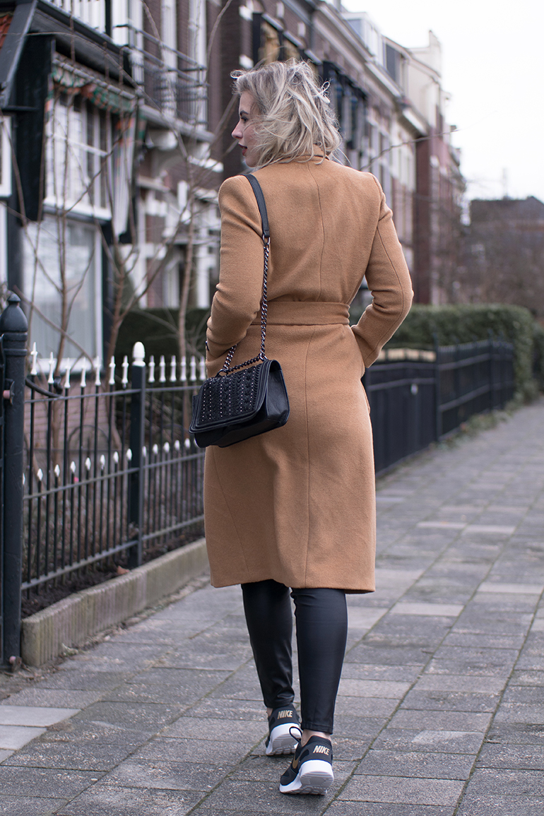 RED REIDING HOOD: Fashion blogger wearing zara chain bag topshop long camel coat leather pants vero moda nike sneakers outfit