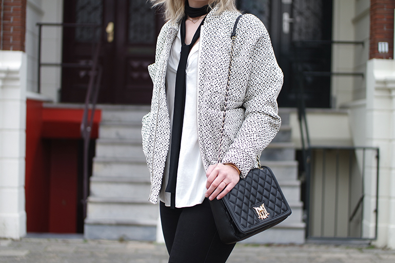 RED REIDING HOOD: Fashion blogger wearing moschino designer quilted bag outfit details carin wester bomber reva jacket long skinny scarf