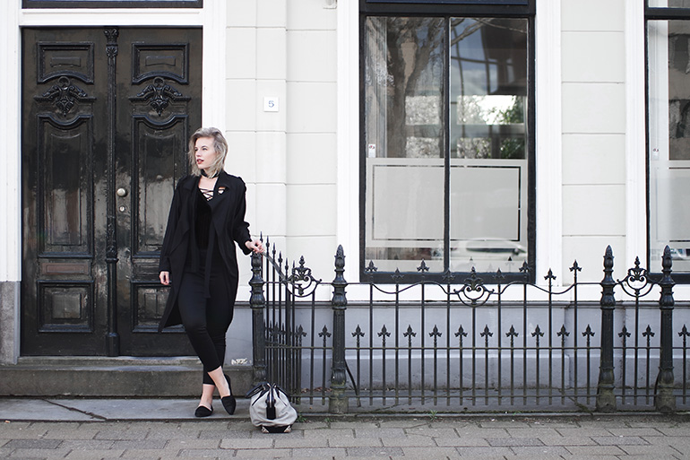 RED REIDING HOOD: Fashion blogger wearing all black everything outfit mango trench coat H&M slacks lace up bodysuit