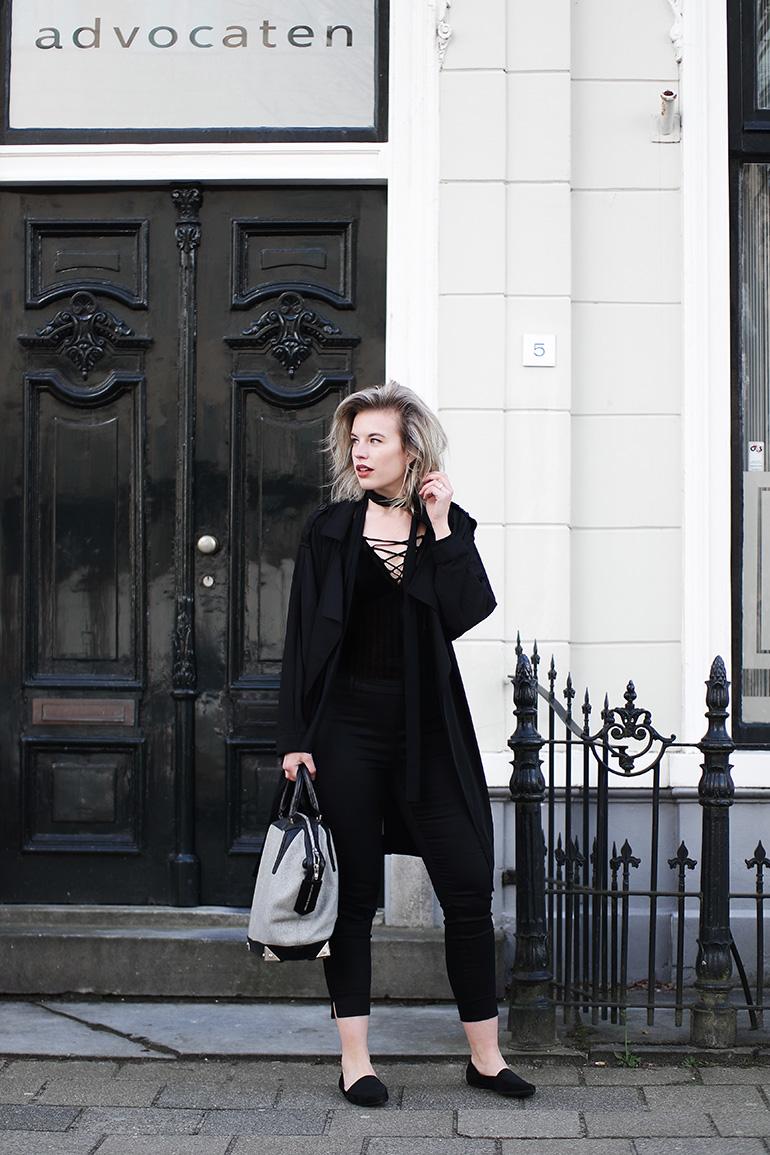 RED REIDING HOOD: Fashion blogger wearing H&M lace up bodysuit all black look outfit H&M slacks alexander wang bag
