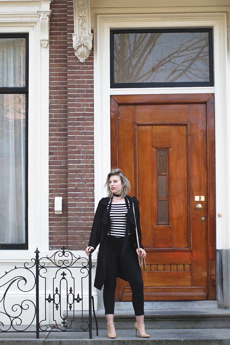 RED REIDING HOOD: Fashion blogger wearing black trench coat outfit slacks striped top skinny scarf