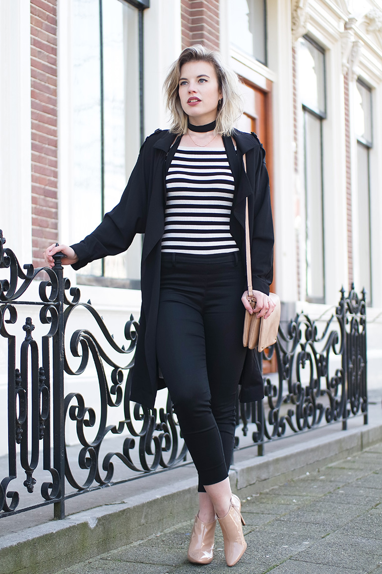 RED REIDING HOOD: Fashion blogger wearing striped top outfit black slacks trench coat parisienne look