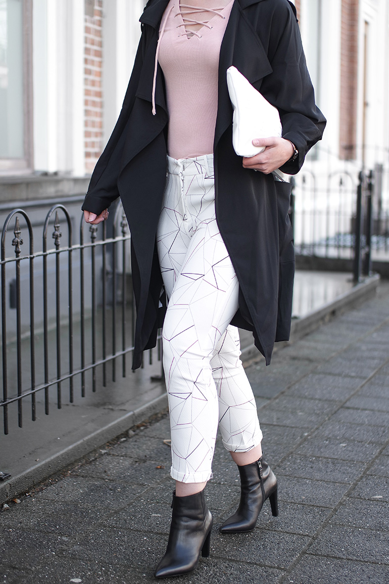 RED REIDING HOOD: Fashion blogger wearing pink lace up top Loavies printed trousers outfit details black trench coat mango