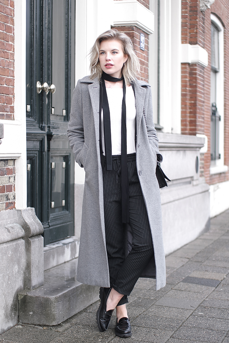 RED REIDING HOOD: Fashion blogger wearing pinstripe joggers loose pants long grey coat skinny scarf outfit