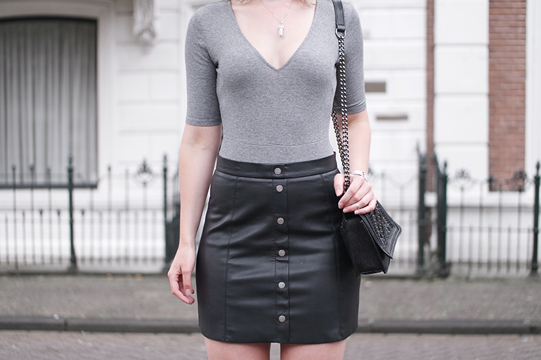 RED REIDING HOOD: Fashion blogger wearing H&M button up faux leather skirt outfit details body suit