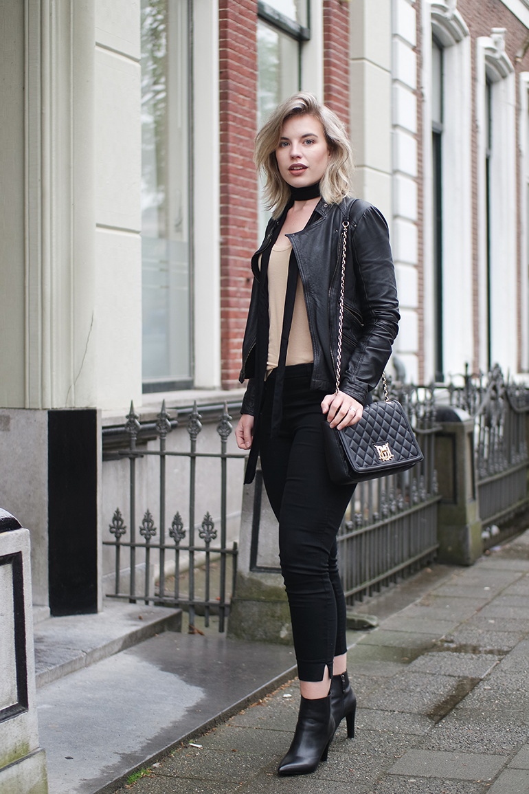 RED REIDING HOOD: Fashion blogger wearing moschino bag leather jacket outfit long skinny scarf H&M slacks