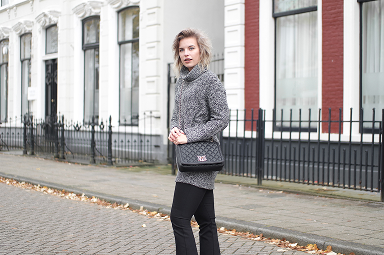 RED REIDING HOOD: Fashion blogger wearing Moschino designer bag outfit turtleneck flared pants