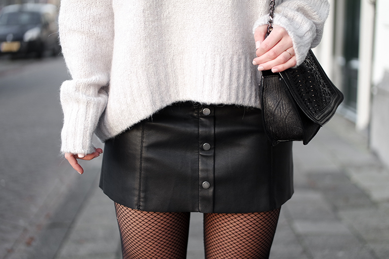 RED REIDING HOOD: Fashion blogger wearing button down leather a-line skirt outfit details fishnet tights