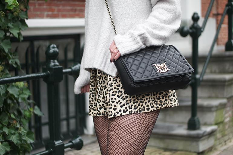 RED REIDING HOOD: Fashion blogger wearing leopard print shorts skirt Zara love moschino bag fishnet tights